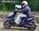 Участник скутерной гонки